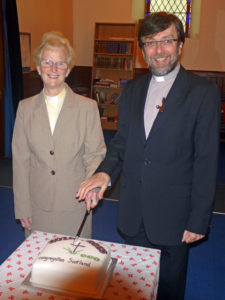 Trevor and Margaret cut the celebration cake