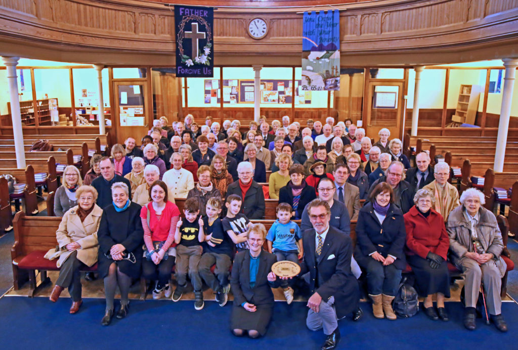 The congregation gathered together after the service with minister Margaret Steele and Session Clerk Colin Macintosh holding the plaque.